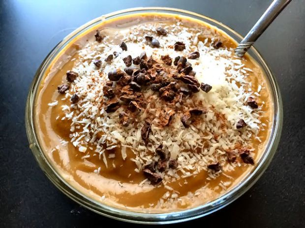 I topped mine with shredded coconut, raw cacao nibs and some cinnamon powder!